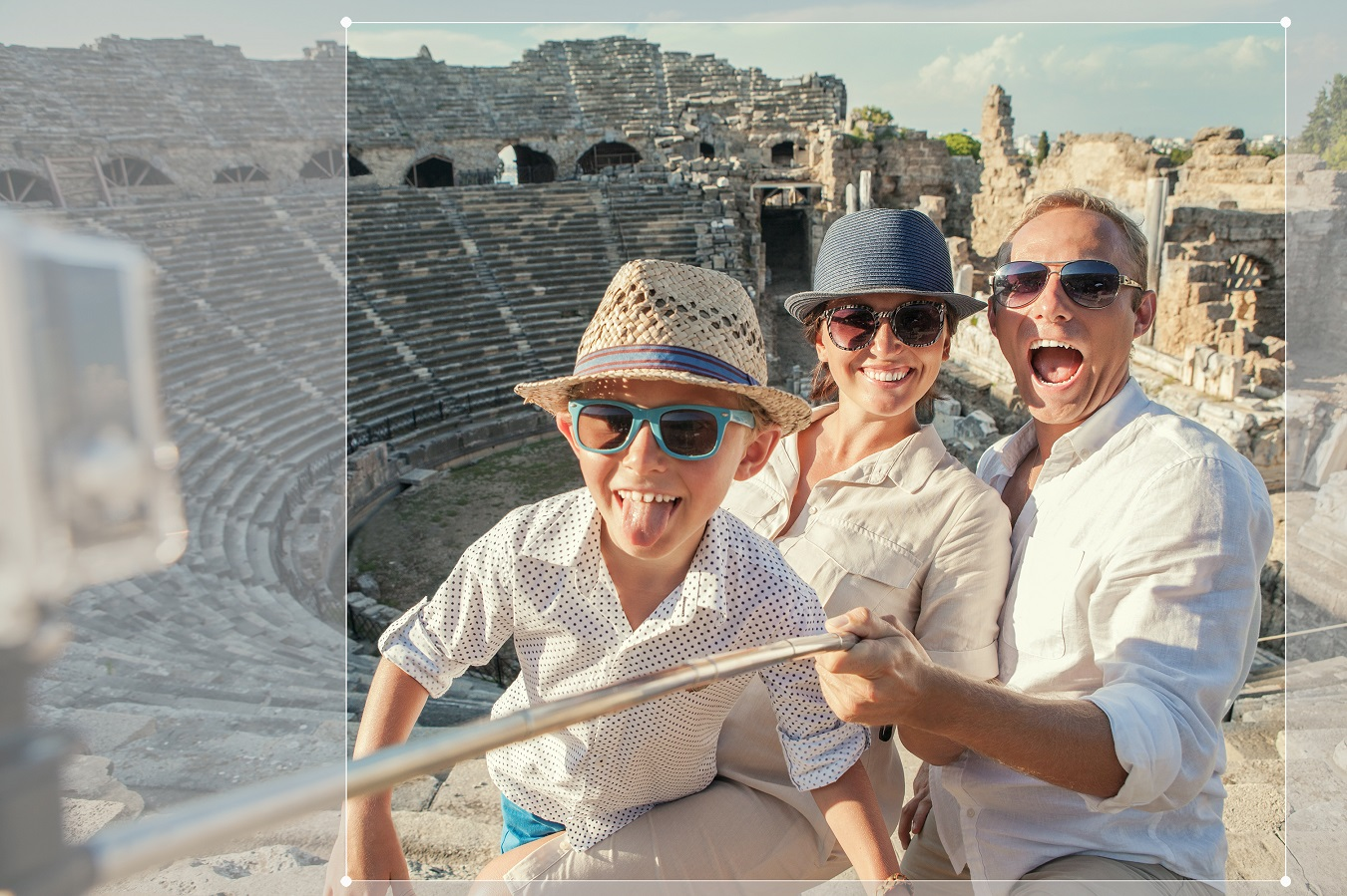 Young positive family take a vacation photo on the Side amphithe